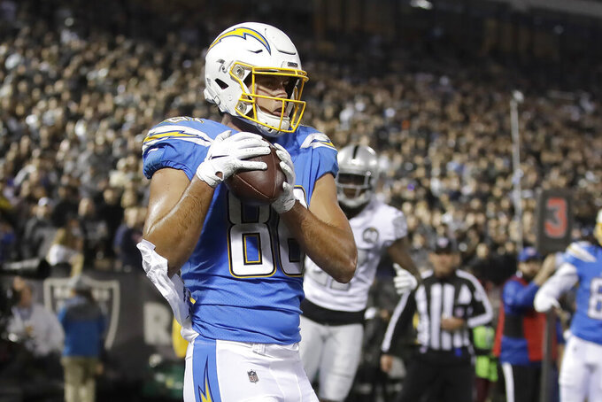 Los Angeles Chargers tight end Hunter Henry (86) catches a touchdown pass against the Oakland Raiders during the first half of an NFL football game in Oakland, Calif., Thursday, Nov. 7, 2019. (AP Photo/Ben Margot)