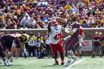 Minnesota quarterback Tanner Morgan, right, throws under pressure from Miami-Ohio defensive line Lonnie Phelps during the first half of an NCAA college football game on Saturday, Sept. 11, 2021, in Minneapolis. Minnesota won 31-26. (AP Photo/Craig Lassig)