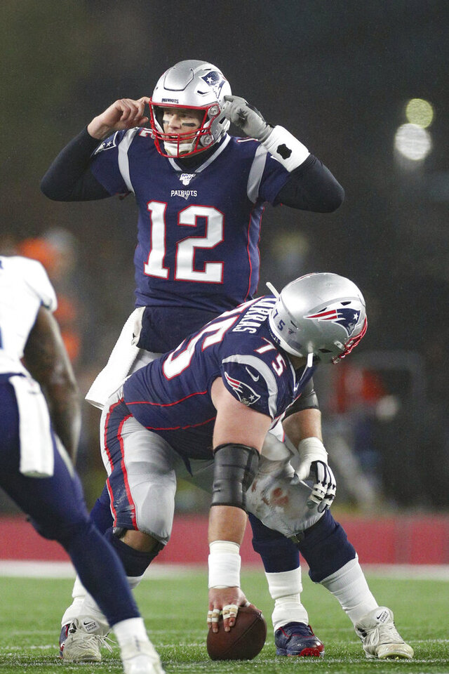 New England Patriots quarterback Tom Brady (12) audibles at the line of scrimmage during an NFL wild-card playoff game against the Tennessee Titans, Saturday, Jan. 4, 2020 in Foxborough, Mass. The Titans defeated the Patriots 20-13. (Margaret Bowles via AP)