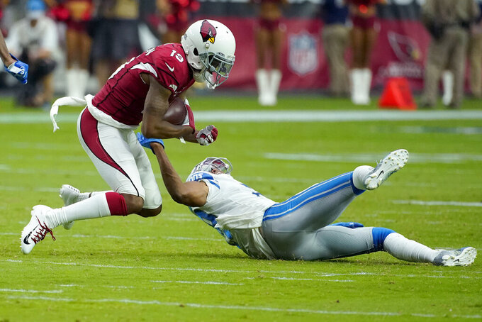 Detroit Lions cornerback Rashaan Melvin tackles Arizona Cardinals wide receiver Trent Sherfield, left, during the second half of an NFL football game, Sunday, Sept. 8, 2019, in Glendale, Ariz. (AP Photo/Rick Scuteri)