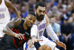 Portland Trail Blazers guard Damian Lillard (0) and Oklahoma City Thunder center Steven Adams (12) reach for the ball in the first half of an NBA basketball game in Oklahoma City, Monday, Feb. 11, 2019. (AP Photo/Sue Ogrocki)