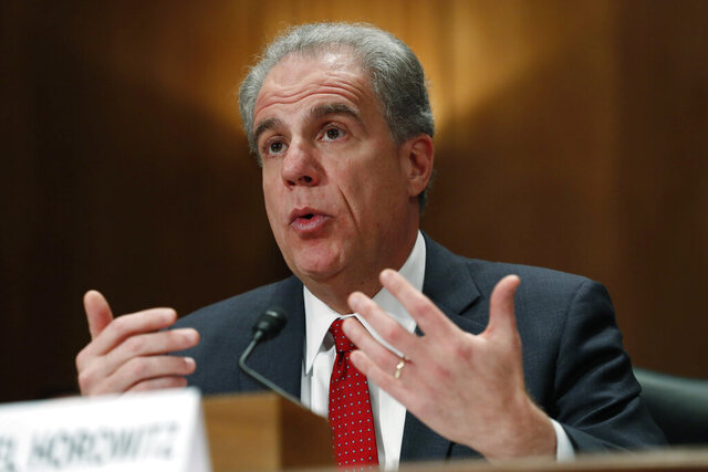 FILE - In this Dec. 18, 2019, file photo Department of Justice Inspector General Michael Horowitz testifies at a Senate committee on FISA investigation hearing on Capitol Hill in Washington. The FBI said Thursday, July 30, 2020, that errors in more than two dozen applications for surveillance warrants were not as severe as the Justice Department inspector general made them out to be. (AP Photo/Jacquelyn Martin, File)