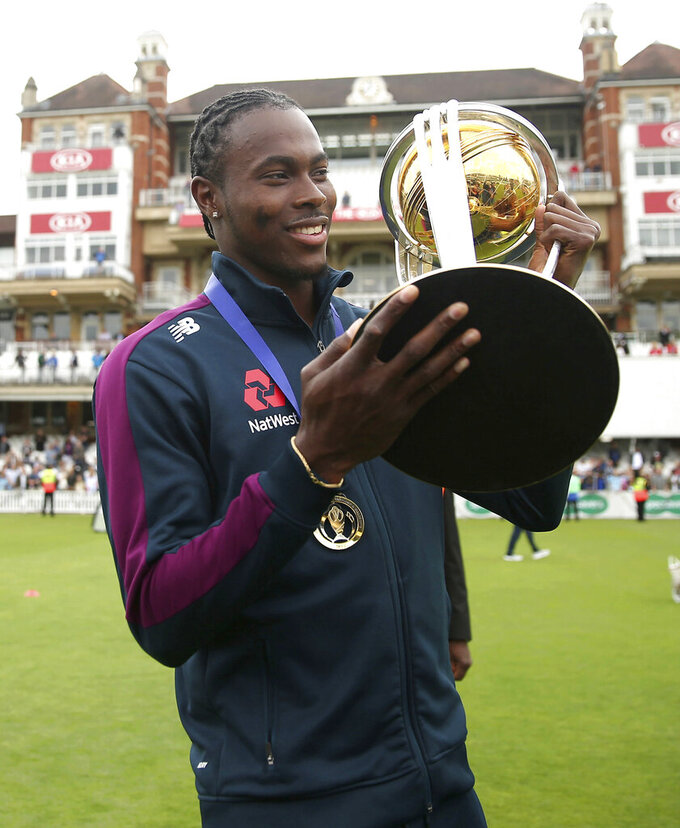 England's Jofra Archer poses with the Trophy during celebrations marking their Cricket World Cup victory on Sunday over New Zealand, during at the Oval cricket ground in London Monday July 15, 2019.  (Steven Paston/PA via AP)