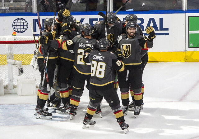 Vegas Golden Knights celebrate after a win over the Chicago Blackhawk in Game 5 of an NHL hockey first-round playoff series, Tuesday, Aug. 18, 2020, in Edmonton, Alberta. The Golden Knights won the series. (Jason Franson/The Canadian Press via AP)