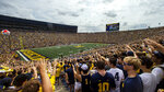 Michigan fans in the student section of Michigan Stadium cheer in the second quarter of an NCAA college football game against Western Michigan in Ann Arbor, Mich., Saturday, Sept. 4, 2021. (AP Photo/Tony Ding)