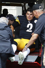 Pittsburgh Steelers quarterback Mason Rudolph (2) is helped from the field after he was injured in the second half of an NFL football game against the Baltimore Ravens, Sunday, Oct. 6, 2019, in Pittsburgh. (AP Photo/Gene J. Puskar)