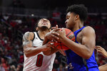 Louisville guard Lamarr Kimble (0) and Indiana State center Tre Williams (1) fight for the ball during the second half of an NCAA college basketball game in Louisville, Ky., Wednesday, Nov. 13, 2019. Louisville won 91-62. (AP Photo/Timothy D. Easley)
