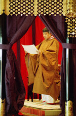 FILE - In this Nov. 12, 1990, file photo, then Japan's Emperor Akihito reads an address as he formally ascends to the Chrysanthemum Throne at the imperial palace in Tokyo. Japan is abuzz ahead of a ceremony Tuesday, Oct. 22, 2019, marking Emperor Naruhito's ascension to the Chrysanthemum Throne. It is one of several formal ceremonies for Naruhito, 59, who has been a full-fledged emperor since succeeding in May after the abdication of his father, Akihito. (AP Photo/Koji Sasahara, File)