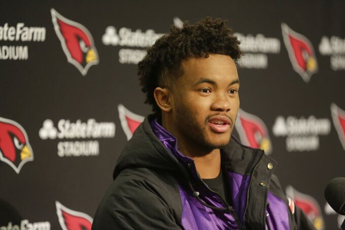 In this Sunday, Dec. 22, 2019, photo, Arizona Cardinals quarterback Kyler Murray talks to reporters during a post-game news conference following an NFL football game against the Seattle Seahawks in Seattle. Murray's impressive first season is early proof that the Arizona Cardinals made a good decision when they selected the quarterback with the No. 1 overall pick in April. (AP Photo/Lindsey Wasson)