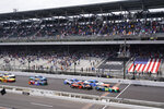 """William Byron (24) leads the field across the """"Yard of Bricks"""" for the start of a NASCAR Series auto race at Indianapolis Motor Speedway, Sunday, Aug. 15, 2021, in Indianapolis. (AP Photo/Darron Cummings)"""