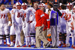 FILE - In this Saturday, Nov. 16, 2019, file photo, New Mexico head coach Bob Davie, center, reacts to a call against Boise State during the first half of an NCAA college football game in Boise, Idaho. On Monday, Nov. 25, Davie agreed to step aside as New Mexico's coach at the end of the season, ending an uneven eight-season tenure with the Lobos. (AP Photo/Steve Conner, File)