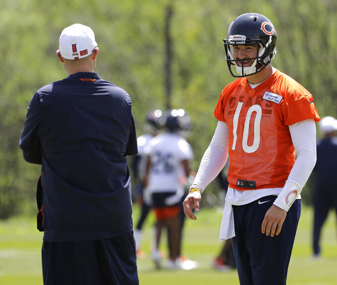FILE - In this May 22, 2019, file photo, Chicago Bears quarterback Mitchell Trubisky, right, smiles as he talks with head coach Matt Nagy during NFL football practice in Lake Forest, Ill. Trubisky is facing some lofty expectations. Bigger things are expected in his second season under coach Matt Nagy and with the Chicago Bears winning the NFC North to reach the playoffs for the first time in eight years. (AP Photo/Nam Y. Huh, File)