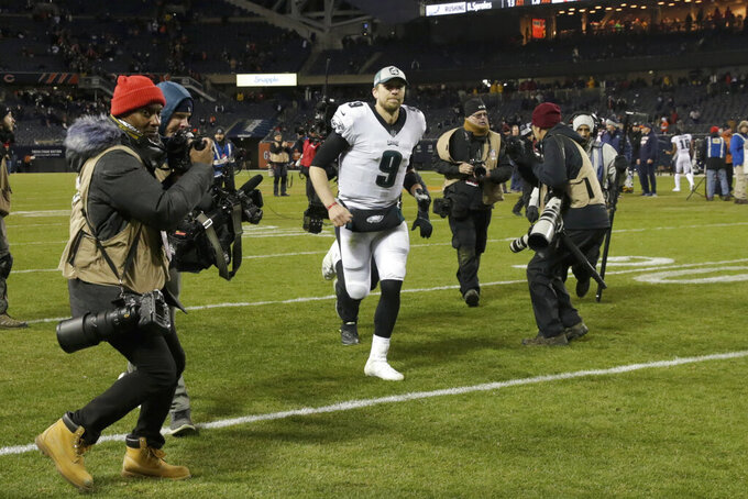 Philadelphia Eagles quarterback Nick Foles (9) runs off the field after an NFL wild-card playoff football game against the Chicago Bears Sunday, Jan. 6, 2019, in Chicago. The Eagles won 16-15. (AP Photo/David Banks)