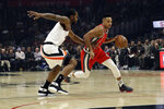 Portland Trail Blazers' CJ McCollum, right, dribbles past Los Angeles Clippers' Kawhi Leonard during the first half of an NBA basketball game Tuesday, Dec. 3, 2019, in Los Angeles. (AP Photo/Marcio Jose Sanchez)
