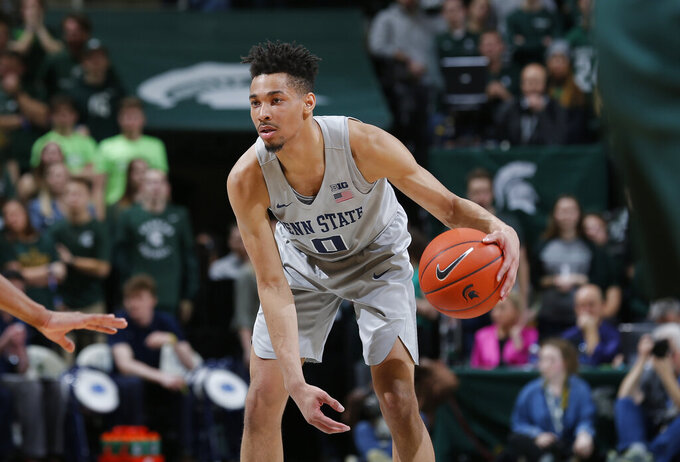 Penn State's Myreon Jones dribbles during the first half of the team's NCAA college basketball game against Michigan State, Tuesday, Feb. 4, 2020, in East Lansing, Mich. (AP Photo/Al Goldis)