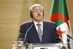 FILE - In this Monday, Sept. 17, 2018 file photo, Algerian Prime Minister Ahmed Ouyahia listens to a question during a press conference in Algiers, Algeria. Former Algerian Prime Minister Ahmed Ouyahia has been imprisoned by a Supreme Court judge investigating corruption, taken in a police van to a prison on the outskirts of the capital. Numerous journalists saw the van leave the Supreme Court on Wednesday, June 12, 2019 for the prison of El Harrach after an hours-long appearance before the investigating judge. (AP Photo/Anis Belghoul, file)