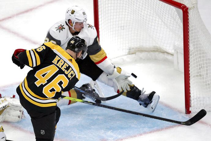 Boston Bruins center David Krejci (46) beats Vegas Golden Knights defenseman Nick Holden (22) for a goal during the third period of an NHL hockey game in Boston, Tuesday, Jan. 21, 2020. (AP Photo/Charles Krupa)