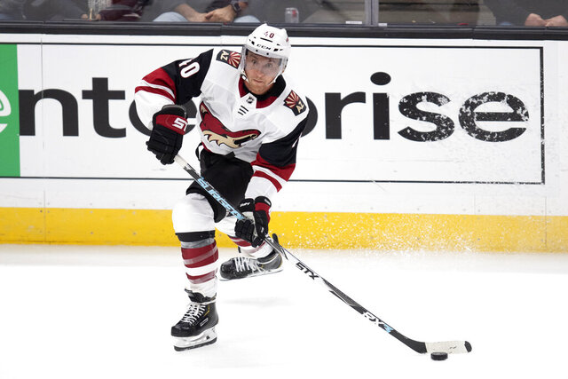 FILE - In this Oct. 3, 2019, file photo, Arizona Coyotes left wing Michael Grabner makes a pass during an NHL hockey game against the Anaheim Ducks in Anaheim, Calif.  The Coyotes placed speedy forward on waivers on Saturday, Oct. 3, 2020, for the purpose of buying out his contract.  (AP Photo/Kyusung Gong, File)