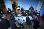 Relatives mourn a man who died during shelling by Armenian forces in Qarayusifli village in Barda region, Azerbaijan, Tuesday, Oct. 27, 2020. Fighting over Nagorno-Karabakh is raging, unimpeded by a U.S.-brokered cease-fire, while Armenia and Azerbaijan are trading blame for the deal's quick unraveling. (AP Photo/Aziz Karimov)
