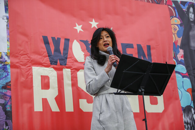 Evelyn Yang, wife of Democratic presidential candidate Andrew Yang speaks during a rally before the Women's March, on Saturday, Jan. 18, 2020 in New York.  Hundred showed up in New York City and thousands in Washington, D.C. for the rallies, which aim to harness the political power of women, although crowds were noticeably smaller than in previous years. Marches were scheduled Saturday in more than 180 cities. (AP Photo/Eduardo Munoz Alvarez)