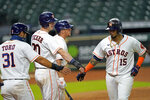 Houston Astros' Martin Maldonado (15) celebrates with Abraham Toro (31) and Kyle Tucker (30) after they all scored on Maldonado's home run against the San Francisco Giants during the sixth inning of a baseball game Wednesday, Aug. 12, 2020, in Houston. (AP Photo/David J. Phillip)