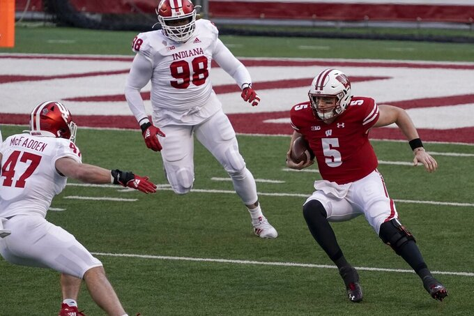Wisconsin's Graham Mertzscrambles during the first half of an NCAA college football game against Indiana Saturday, Dec. 5, 2020, in Madison, Wis. (AP Photo/Morry Gash)