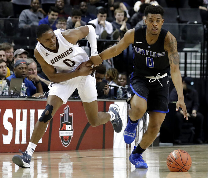 Saint Louis guard Jordan Goodwin, right, dribbles as St. Bonaventure guard Kyle Lofton (0) holds his arm during the second half of an NCAA college basketball game in the Atlantic 10 men's tournament final Sunday, March 17, 2019, in New York. Saint Louis won 55-53. (AP Photo/Julio Cortez)