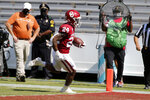 Oklahoma running back Marcus Major (24) scores a rushing touchdown against Texas during an NCAA college football game in Dallas, Saturday, Oct. 10, 2020. (AP Photo/Michael Ainsworth)