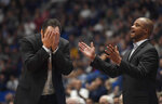 Wichita State head coach Gregg Marshall, left, and assistant coach Isaac Brown are shown during  the second half of an NCAA college basketball game in Hartford, Conn., Sunday, Jan. 12, 2020. Wichita State coach Gregg Marshall resigned Tuesday, Nov. 17, 2020, following an investigation into allegations of verbal and physical abuse, ending a tenure that soared to the Final Four and crashed on the eve of the upcoming season. Shockers assistant coach Isaac Brown will serve as the interim coach. (AP Photo/Jessica Hill, File)