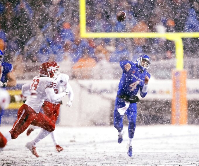 Boise State quarterback Brett Rypien (4) throws a pass against Fresno State during a heavy snowfall in an NCAA college football game for the Mountain West Conference championship Saturday, Dec. 1, 2018, in Boise, Idaho. (Darin Oswald/Idaho Statesman via AP)