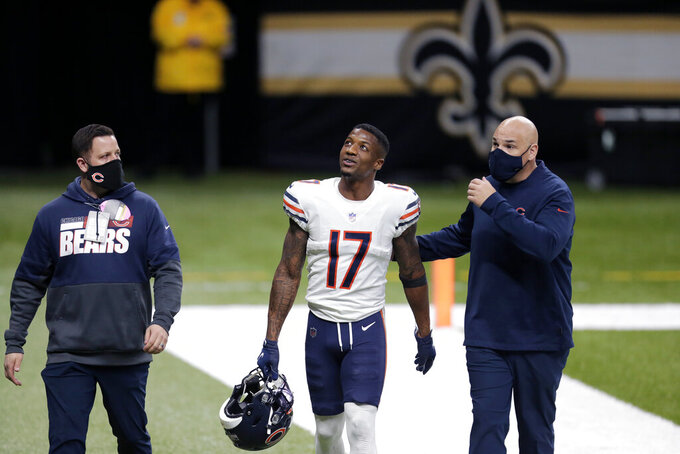 Chicago Bears wide receiver Anthony Miller (17) walks off the filed after being ejected for unsportsmanlike conduct in the second half of an NFL wild-card playoff football game against the New Orleans Saints in New Orleans, Sunday, Jan. 10, 2021. (AP Photo/Brett Duke)