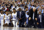 FILE - In this April 4, 2016, file photo, North Carolina head coach Roy Williams, right and his players on the bench react after the NCAA Final Four tournament college basketball championship game against Villanova, in Houston. Villanova won 77-74. (AP Photo/David J. Phillip)