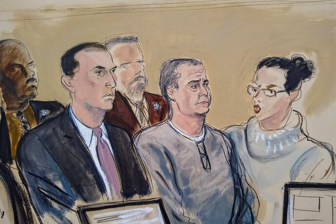 In this courtroom sketch, defense attorney Cesar de Castro, left, Mexico's former top security official Genaro Garcia Luna, center, and a court interpreter, appear for an arraignment hearing in Brooklyn federal court Friday, Jan. 3, 2020, in New York. Garcia Luna pleaded not guilty to charges he accepted a fortune in drug-money bribes from kingpin Joaquin