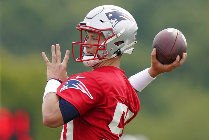 New England Patriots quarterback Mac Jones winds up for a pass during an NFL football practice, Wednesday, Aug. 4, 2021, in Foxborough, Mass. (AP Photo/Steven Senne)