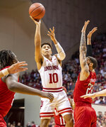 Indiana guard Rob Phinisee (10) shoots around the defense of Nebraska guard Haanif Cheatham (22) during the first half of an NCAA college basketball game, Friday, Dec. 13, 2019, in Bloomington, Ind. (AP Photo/Doug McSchooler)