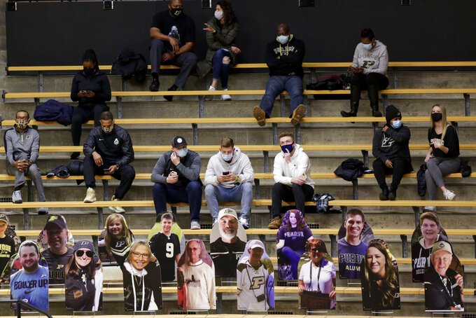 Spectators sit above a row of cardboard cutouts during the first half of an NCAA college basketball game between Oakland and Purdue Tuesday, Dec. 1, 2020 in West Lafayette, Ind. (Nikos Frazier/Journal & Courier via AP)