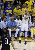 Golden State Warriors guard Stephen Curry (30) shoots a 3-point basket as Portland Trail Blazers center Enes Kanter (00) watches during the second half of Game 1 of the NBA basketball playoffs Western Conference finals in Oakland, Calif., Tuesday, May 14, 2019. (AP Photo/Jeff Chiu)
