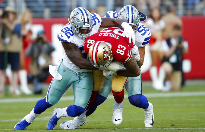 San Francisco 49ers tight end Levine Toilolo (83) is tackled by Dallas Cowboys defensive end Dorance Armstrong (92) and outside linebacker Leighton Vander Esch (55) during the first half of an NFL preseason football game in Santa Clara, Calif., Saturday, Aug. 10, 2019. (AP Photo/John Hefti)
