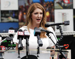 Barbara Poma, left, CEO of the onePulse foundation speaks during a news conference to introduce legislation that would designate the Pulse nightclub site as a national memorial, Monday, June 10, 2019, in Orlando, Fla. (AP Photo/John Raoux)