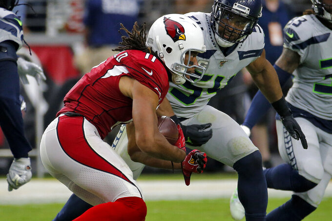 Arizona Cardinals wide receiver Larry Fitzgerald (11) catches his career 1,325 catch to tie Tony Gonzalez for second place on the all-time receptions list during the second half of an NFL football game against the Seattle Seahawks, Sunday, Sept. 29, 2019, in Glendale, Ariz. (AP Photo/Rick Scuteri)