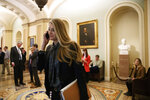 Sen. Kelly Loeffler, R-Ga., walks through the Capitol, Monday, Jan. 27, 2020, in Washington, before the impeachment trial of President Donald Trump on charges of abuse of power and obstruction of Congress. (AP Photo/ Jacquelyn Martin)