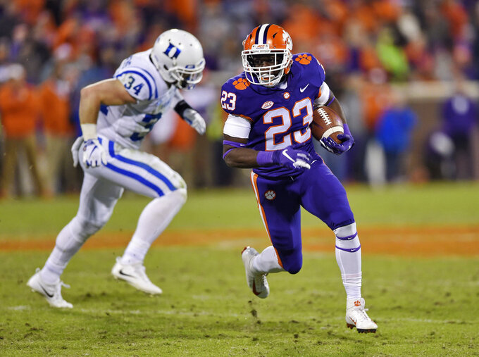 Clemson's Lyn-J Dixon rushes while defended by Duke's Ben Humphreys during the second half of an NCAA college football game Saturday, Nov. 17, 2018, in Clemson, S.C. (AP Photo/Richard Shiro)