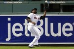 Boston Red Sox's Jackie Bradley Jr. makes the catch on a fly out by Baltimore Orioles' Ryan Mountcastle during the first inning of a baseball game Tuesday, Sept. 22, 2020, in Boston. (AP Photo/Michael Dwyer)