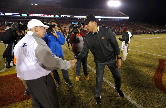Kansas State head coach Bill Snyder, left, shakes hands with Iowa State head coach Matt Campbell as they greet before an NCAA college football game, Saturday, Nov. 24, 2018, in Ames, Iowa. (AP Photo/Charlie Neibergall)