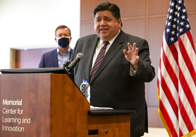 FILE - In this Sept. 21, 2020, Illinois Gov. J.B. Pritzker speaks in Springfield, Ill. Central and west-central Illinois, including the capital city, became the latest region of the state to face restrictions on social interaction Thursday, Oct. 29, 2020, because of an elevated rate of positive tests for COVID-19. The Region 3 restrictions which take effect Sunday, halt indoor bar and restaurant service, closes those establishments at 11 p.m. and limits the size of gatherings to 25 people or 25% of a room's capacity. (Justin L. Fowler/The State Journal-Register via AP)
