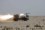 In this photo provided Thursday, June 18, 2020, by the Iranian Army, a missile is launched during a naval exercise. State media reported Thursday that Iran test fired cruise missiles in a naval exercise in the Gulf of Oman and northern Indian Ocean. The report by the official IRNA news agency said the missiles destroyed targets at a distance of 280 kilometers (170 miles). (Iranian Army via AP)
