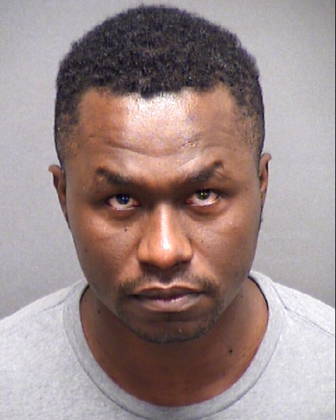 This photo provided by the Bexar County Texas, Sheriff's Office shows 40-year-old Andre McDonald. The Air Force major based in San Antonio has been charged with murder after authorities found the remains of his wife whom he reported missing in March. McDonald is being held Monday, July 15, 2019, at the Bexar (bayr) County jail. Bail is set at $2 million. (Bexar County Sheriff's Office via AP)