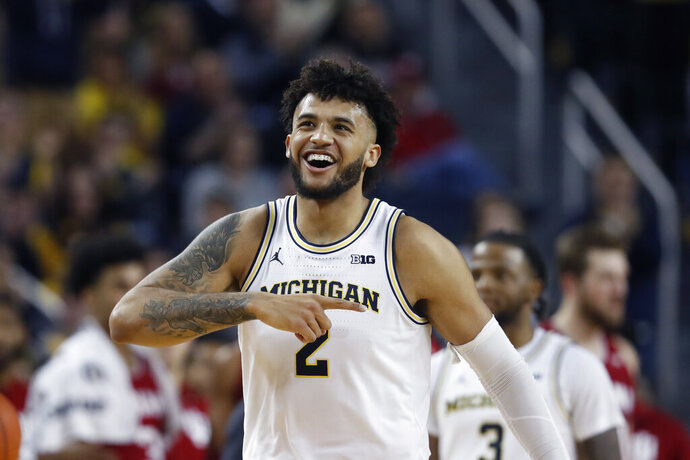 Michigan forward Isaiah Livers walks to the bench after a play during the second half of the team's NCAA college basketball game against Indiana, Sunday, Feb. 16, 2020, in Ann Arbor, Mich. (AP Photo/Carlos Osorio)