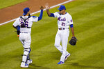New York Mets relief pitcher Edwin Diaz (21) celebrates with catcher Robinson Chirinos (26) after the Mets' 7-6 victory over the Baltimore Orioles in a baseball game Wednesday, Sept. 9, 2020, in New York. (AP Photo/Kathy Willens)