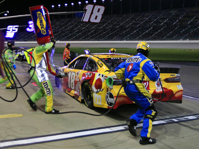 Kyle Busch pits during the NASCAR Cup Series auto race at Kansas Speedway in Kansas City, Kan., Saturday, May 11, 2019. (AP Photo/Orlin Wagner)